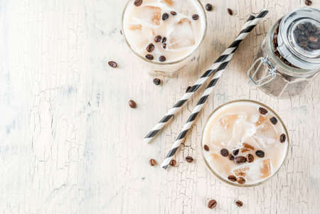 Summer cold Iced coffee frappe with milk and ice cubes, light concrete background copy space top view Stock Photo