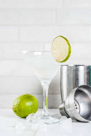 Homemade summer refreshment drink,  lime and lemon margarita cocktail beverage, white marble background copy space Stock Photo
