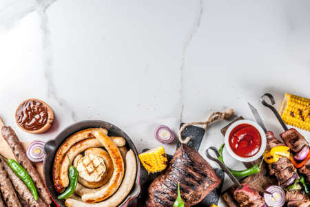 Assortment various barbecue food grill meat, bbq party fest - shish kebab, sausages, grilled meat fillet, fresh vegetables, sauces, spices, white marble background, above copy space Stock fotó