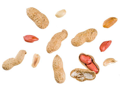 Whole and open peanut nuts isolated on a white background simple pattern