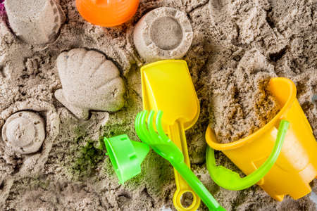 Summer vacation concept, Children's holidays background, sea sand and beach bright plastic toys, top view copy space Standard-Bild - 102578126