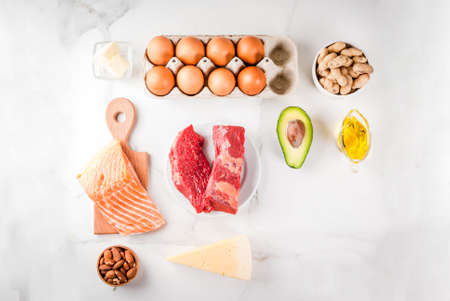 Ketogenic low carbs diet concept. Healthy balanced food with high content of healthy fats. Diet for the heart and blood vessels. Organic food ingredients, white marble background, copy space top view Stockfoto - 102741538