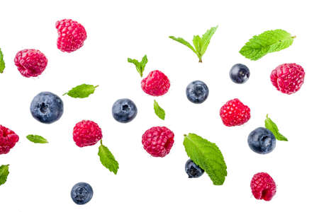 Creative layout, background, with fresh berries, simple pattern on white background. Raspberry, blueberry, mint leaves, slices of lemon.  Banco de Imagens
