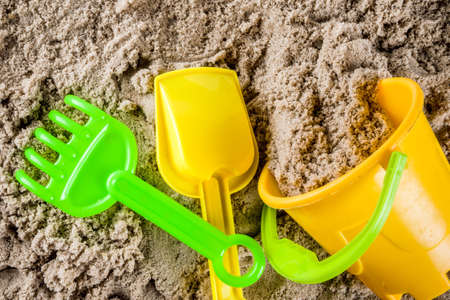 Summer vacation concept, Children's holidays background, sea sand and beach bright plastic toys, top view copy space Standard-Bild - 103121614