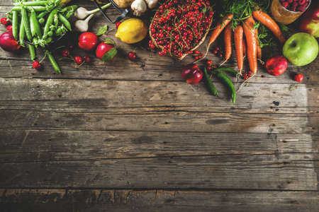 Fresh summer fruit, berry and vegetables on wooden rustic background copy space above 版權商用圖片