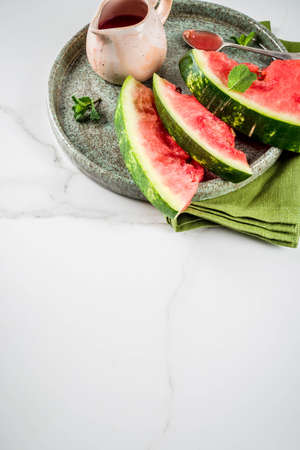 Homemade sweet and sour watermelon sauce, white marble background copy space