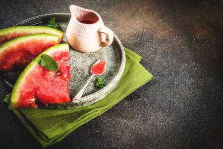Homemade sweet and sour watermelon sauce, dark rusty background copy space