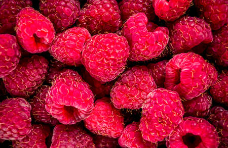 Raw fresh raspberry, close top view, fruit background