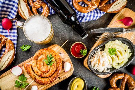 Oktoberfest food menu, bavarian sausages with pretzels, mashed potato, sauerkraut, beer bottle and mug, dark rusty background copy space top view