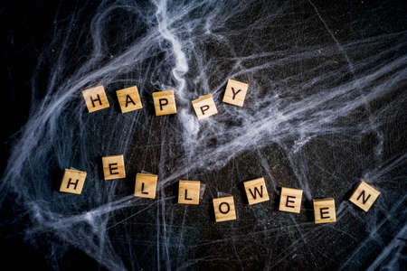 Halloween concept, a dark background old wall with cobwebs, greeting card background