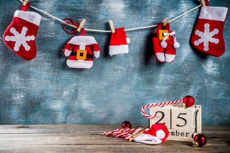 Christmas celebration concept with old retro styled wooden calendar, christmas gift and decorations, copy space