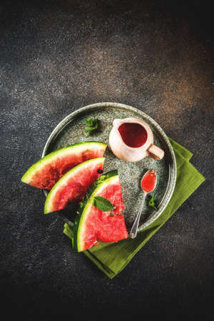 Homemade sweet and sour watermelon sauce, dark rusty background copy space top view