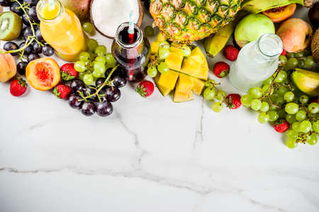 Different fruit juices smoothies concept, summer vitamins diet, with tropical fruits and berries on a light background, 版權商用圖片