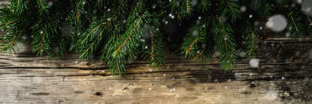 Christmas and Happy New Year holiday background with natural fir spruce, on wooden background, Winter Greeting Card  concept with copy space for text. banner Stock Photo