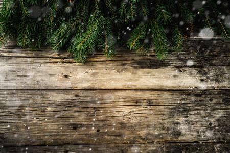 Christmas and Happy New Year holiday background with natural fir spruce, on wooden background, Winter Greeting Card  concept with copy space for text.