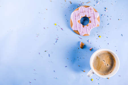 Rest and relaxation concept, coffee cup and biscuits donut with sugar coating, with a notepad for notes or wishes on a bright trendy background, top view space for text Stock Photo