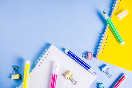 Back to school background, with bright accessories supplies for school and study - pen, pencils, markers, pencils, rulers, paperclips, sticks, notebooks. On a light blue background, top view, free copy space for text Stockfoto