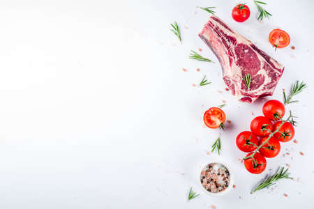 Raw rib eye beef steak meat with spices and ingredients for cooking white background copy space top view 스톡 콘텐츠