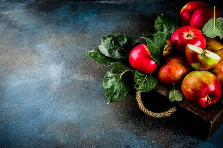 Raw fresh apples on light linen cloth background, copy space