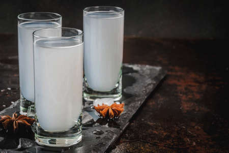 Traditional arabic alcohol drink Raki with anise, dark rusty background copy space Stock Photo