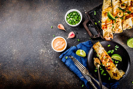 Mexican latin american food, Baked Roasted Shrimp Enchiladas with Jalapeno and Lime Cream Sauce 版權商用圖片