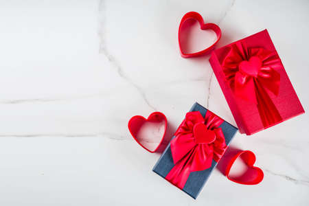 Romantic Valentines gift boxes with heart tied ribbons decoration, top view copy space