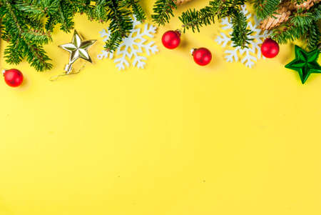 Christmas holiday festive background with pine cones, xmas tree branches  and decorations top view copy space Stok Fotoğraf - 129906749