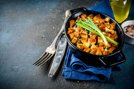 Traditional Thanksgiving, Christmas stuffing in baking pan, dark blue concrete background top view copy space Stok Fotoğraf