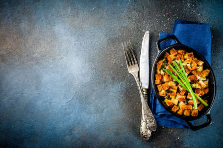 Traditional Thanksgiving, Christmas stuffing in baking pan, dark blue concrete background top view copy space Stock Photo