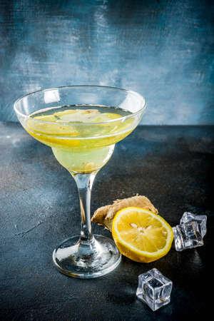 Autumn winter seasonal alcohol Gingersnap cocktail, Ginger lemon ale, dark blue background copy space