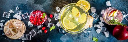 Various autumn winter seasonal alcohol cocktail Apple Rosemary, Cranberry vodka, Ginger lemon ale,  Almande Horchata,  dark blue background copy space