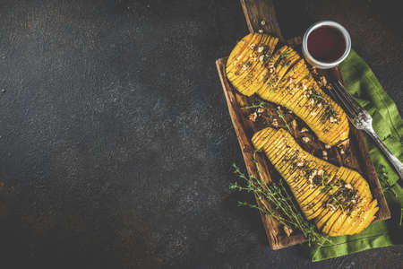 Simple autumn domestic recipes, roasted hasselback butternut squash pumpkin with thyme, honey and maple syrup,