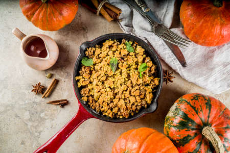 Homemade autumn pastries, pumpkin crumble pie in a cast-iron frying pan, light stone background, copy space top view Stock Photo - 109320182
