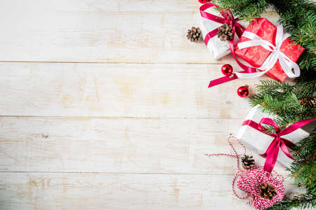 Christmas background with Christmas present gifts box and decoration, fir tree branches, classic white wooden background copy space 版權商用圖片