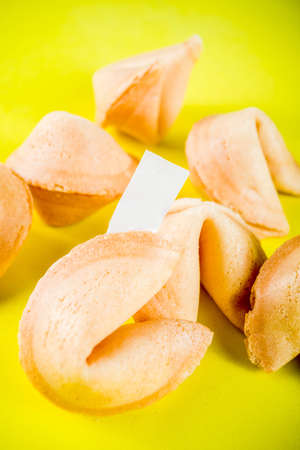 Chinese fortune cookie with prediction on bright yellow background top view copy space Stock Photo