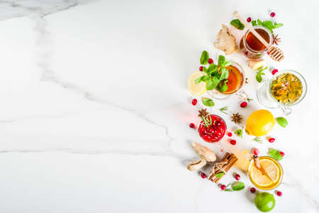 Various autumn winter herbal fruit and berry tea, with cranberry, mint, rosemary, lemon. lime. flowers, medical herbs and spices. top view copy space Stok Fotoğraf