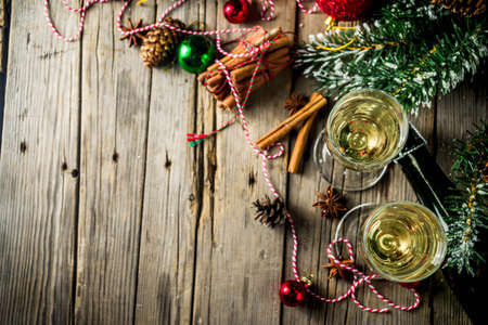 Two glasses of champagne with Christmas decoration on wooden background, Happy New Year and Xmas Celebration. Copy space