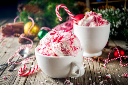 Christmas dessert, Homemade Peppermint Candy Cane Ice Cream in two cups, old wooden background with xmas decorations copy space Zdjęcie Seryjne