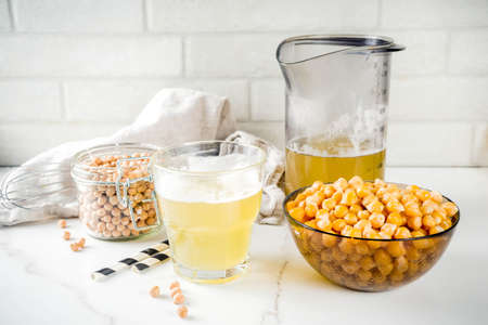 Chickpea broth aquafaba, liquid water brine, Replace egg in baking for vegan recipe. Vegan diet drink, white marble background copy space Фото со стока - 111852414
