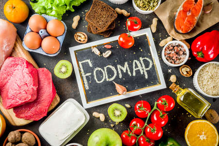 Healthy diet food. Various low fodmap ingredients selection - meat, vegetables, berry, fruit, grains, Trendy healthy lifestyle concept. On dark rusty background copy space top view Banque d'images - 111990760