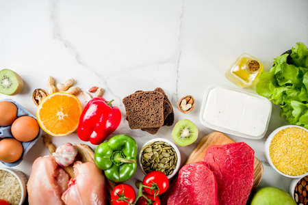Healthy diet food. Various low fodmap ingredients selection - meat, vegetables, berry, fruit, grains, Trendy healthy lifestyle concept. On white marble background copy space top view Imagens