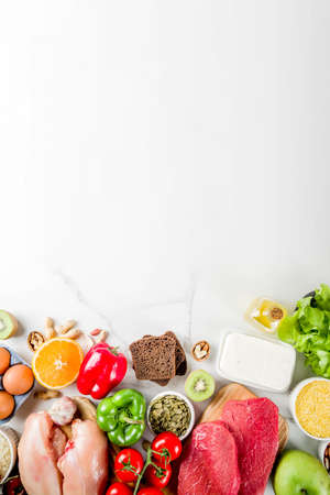 Healthy diet food. Various low fodmap ingredients selection - meat, vegetables, berry, fruit, grains, Trendy healthy lifestyle concept. On white marble background copy space top view Stock Photo