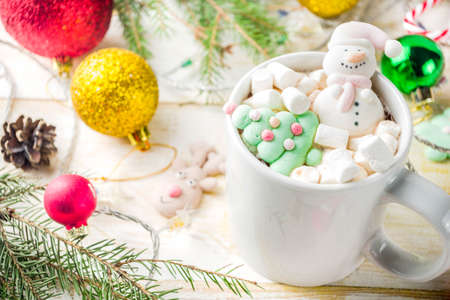 Creative idea for christmas drink, delicious hot chocolate with funny marshmallow snowman, christmas tree, rain dear, santa, on home background with xmas decoration copy space top view Stock Photo