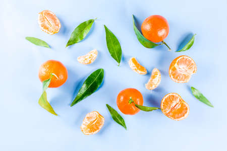 Fresh raw organic tangerines with leaves, top view flatlay copy space