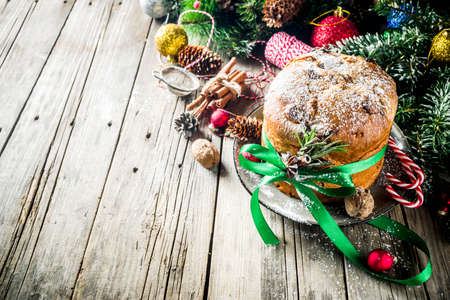 Traditional Christmas panettone with dried fruits and nuts, on old wooden background wth christmas decoration copy space top view Foto de archivo - 113023569