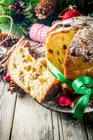 Traditional Christmas panettone with dried fruits and nuts, on old wooden background wth christmas decoration copy space top view Foto de archivo - 113023573