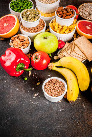Diet food background concept, healthy carbohydrates (carbs) products - fruits, vegetables, cereals, nuts, beans, dark blue concrete background copy space Stock Photo - 113218987