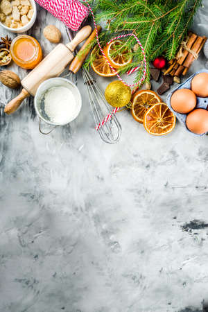 Christmas winter baking concept, ingredients for making cookies, baking, pies. Dried orange slices, spices,utensils, grey marble background copy space top view Stock Photo