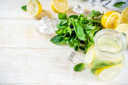 Homemade sour cocktail lemonade, with fresh lemons, mint and honey, white wooden background copy space Stok Fotoğraf