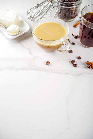 Trendy ketogenic diet food, Bulletproof coffee with milk and butter, white marble background copy space